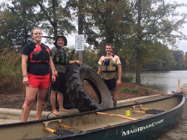 Students pull tire from lake